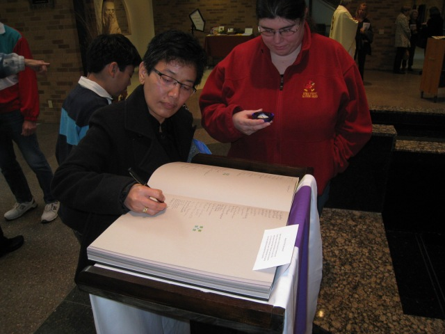 signing names into the book